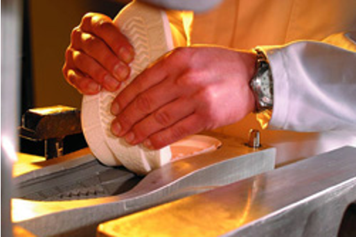 A PU midsole is peeled from a steel mold